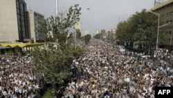 Iran -- Iranian supporters of defeated presidential candidate Mir Hossein Musavi march in Tehran, 15Jun2009.