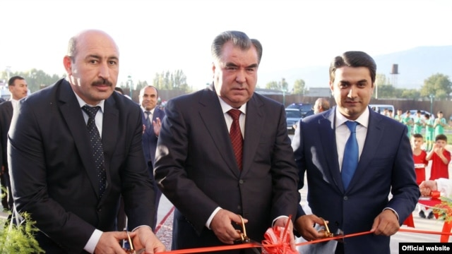 Tajik President Emomali Rahmon (center) with his son Rustami Emomali (left) in December