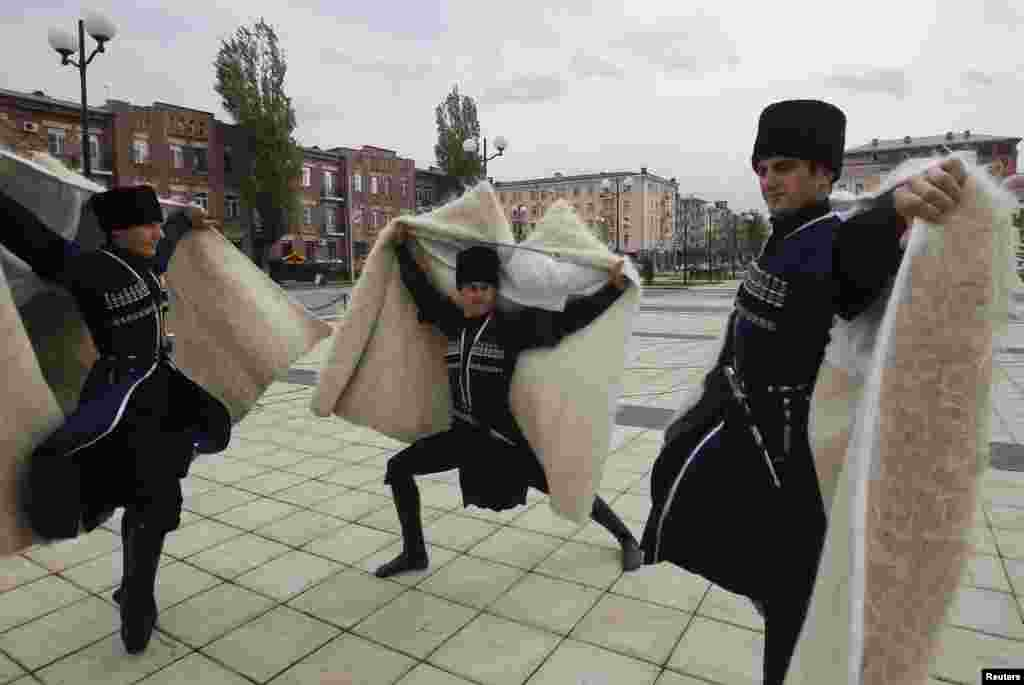 Members of a Chechen dance group pose on Chechen Language Day.