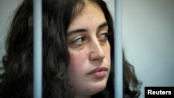 Одна из арестованных активистов Гизем Акхан