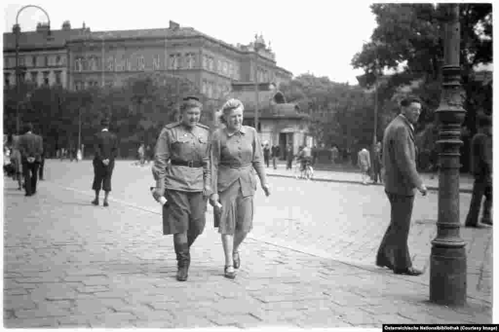 A Soviet soldier strolling central Vienna with a friend in 1946. Vienna's western suburbs were split into British, American, and French sections, while the Soviet Union held Vienna's east.