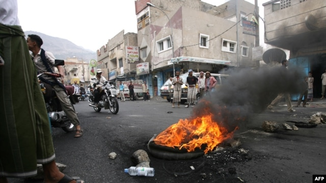 Antiregime activists block a main road in the Yemeni flashpoint city of Taiz.