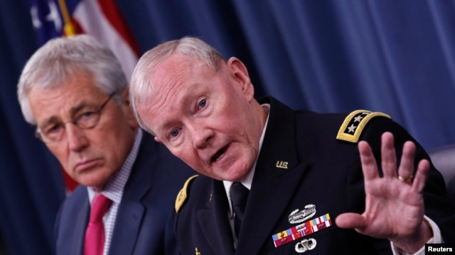 U.S. Chairman of the Joint Chiefs of Staff General Martin Dempsey (right) speaks next to U.S. Secretary of Defense Chuck Hagel during a media briefing at the Pentagon in Washington on July 3.