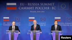 Russian President Vladimir Putin (left to right), European Council President Herman Van Rompuy, and European Commission President Jose Manuel Barroso address a joint news conference in Brussels on January 28.