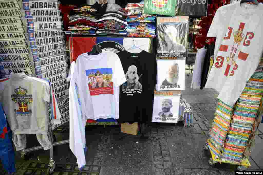 "More Putin T-shirts, but not in good company. One T-shirt to Putin's right features ""Dr. Dabic,"" the pseudonym under which 1990s Bosnian Serb leader Radovan Karadzic evaded justice for nearly 13 years before his arrest in 2008."