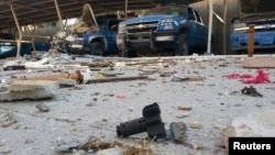 Police vehicles are parked next to debris in the Anbar town of Hit earlier this month.