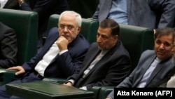 Iran's Foreign Minister Javad Zarif (L), attends a parliament session to discuss the president's proposed cabinet in Tehran, August 15, 2017