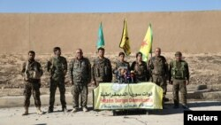 Syrian Democratic Forces commanders attend a news conference in Ain Issa to announce their decision to launch a campaign to retake the Syrian town of Raqqa from Islamic State.
