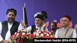 Ashraf Ghani (C), Afghan incumbent president and presidential candidate, stands with Amrullah Saleh (R), his vice presidential candidate, during his election campaign in Jalalabad on September 20.