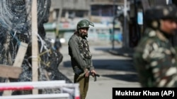 Indian soldiers stand guard in the disputed region of Kashmir (file photo)