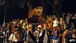 A protester holds up a picture of Turkish Republic founder Mustafa Kemal Ataturk in Istanbul.