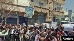 Mostly ethnic Kurdish demonstrators marched after Friday prayers in Qamishli, Syria, on April 15.