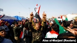 Iraqi demonstrators chant slogans during ongoing anti-government protests in Najaf, February 6, 2020
