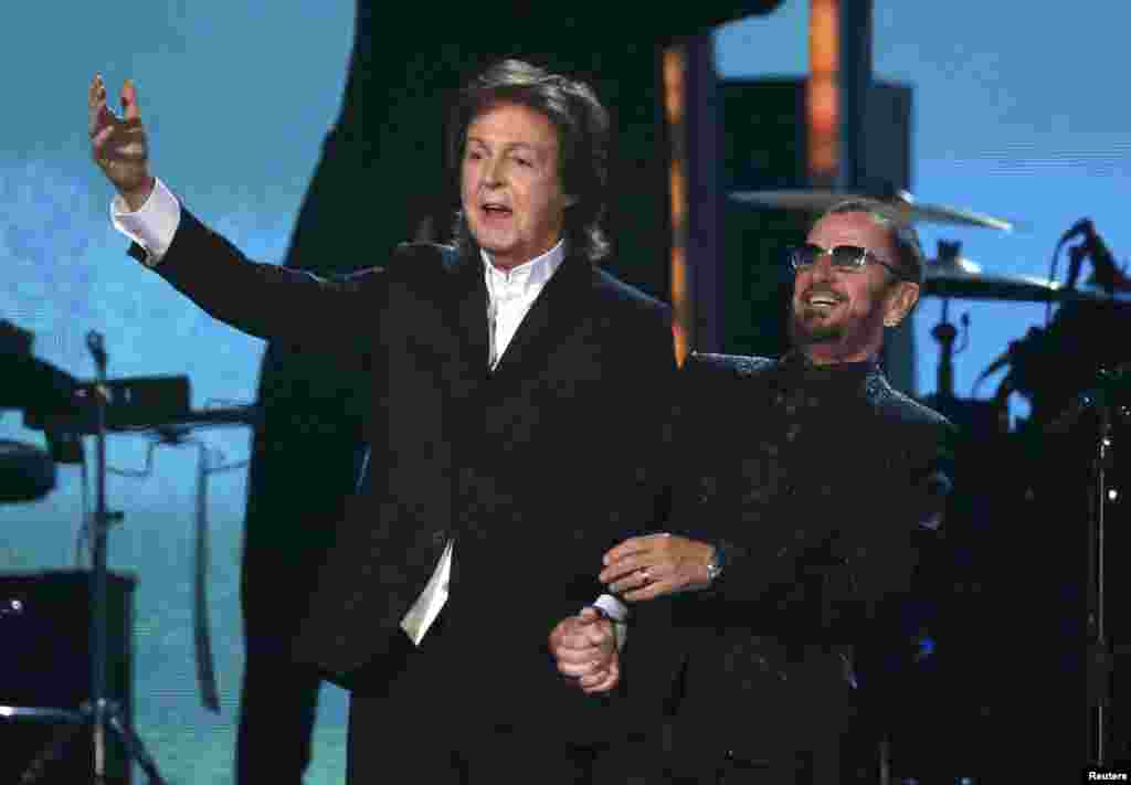 The only surviving former Beatles, Paul McCartney (left) and Ringo Starr, prepare to take a bow after performing together at the 56th annual Grammy Awards in Los Angeles. (Reuters/Mario Anzuoni)