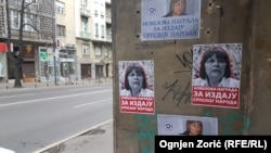 Posters by extreme nationalists denouncing Serbian human rights activist Natasa Kandic are posted on a building in Belgrade.