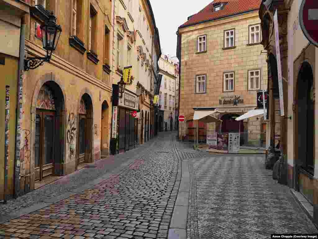 Empty lanes in the heart of Prague's historic tourist district.
