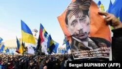 Плакат із зображенням президента Росії Володимира Путіна під час акції «Червоні лінії для Зе». Київ, 8 грудня 2019 року