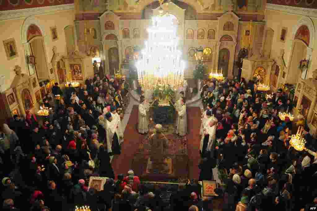 In Azerbaijan's capital, Baku, people attend an Orthodox Christmas service early on January 7, 2014.