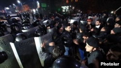 Armenian protesters clash with riot police on January 15 near the Russian Consulate in Gyumri, where the family was killed in their home.