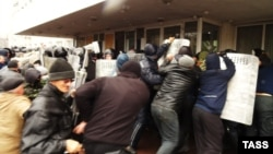 Pro-Russia protesters storm the mayor's office in Mariupol on April 13.