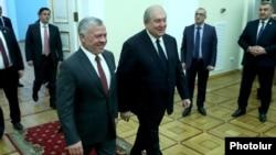 Armenia -- Armenian President Armen Sarkissian (R) and Jordan's King Abdullah arrive at the presidential palace in Yerevan, February 11, 2020.