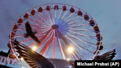 A seagull in front of a Ferris wheel at the Christmas market in Schwerin, Germany. (AP/Michael Probst)