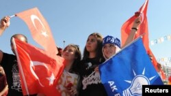 Supporters of Turkish Prime Minister Tayyip Erdogan attend a pro-government rally on June 23.