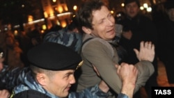 Police detain a protester in Moscow on October 12.
