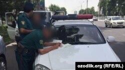 Сотрудники Управления безопасности дорожного движения Ташкента.