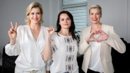 Using gestures that would later become iconic opposition symbols, Svatlana Tsikhanouskaya clenches her fist, Maryya Kalesnikava makes a heart sign, and Veranika Tsapkala signals V for victory while campaigning ahead of Belarus's disputed presidential election in 2020.