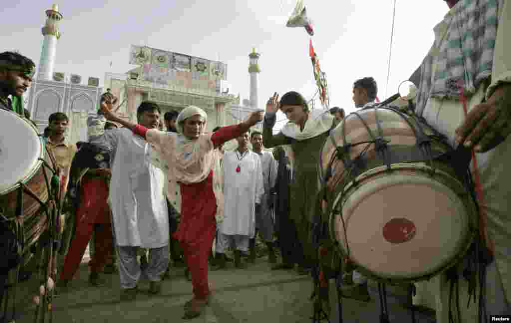 Sufis dance at the shrine in 2008. During the festival the air is heavy with drumbeats, chanting and cannabis smoke.
