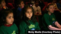 "Children attend a prelaunch promotional event in Afghanistan for ""Baghch-e-Simsim."""