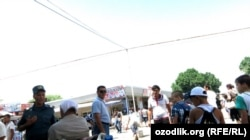 Officials clear beggars on the streets of Tashkent on June 24.