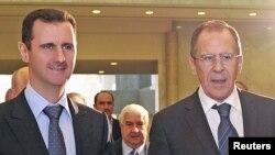 سرگئی لاوروف (راست) در جریان دیدار روز سه شنبه از دمشق و دیدار با بشار اسد، رییس جمهوری سوریه