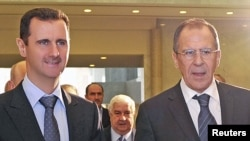 Başar al-Assad Orsýetiň daşary işler ministri Sergeý Lawrow bilen Damaskda, 7-nji fewral.