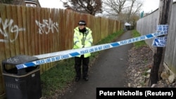 A police officer stands behind cordon near the home of Russian ex-spy Sergei Skripal in Salisbury on March 28.