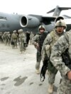 U.S. soldiers leave a plane as they arrive from Afghanistan at the Manas air base in February 2009.