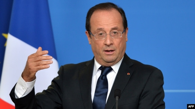 French President Francois Hollande says he wants proof that Iran has abandoned military nuclear research.