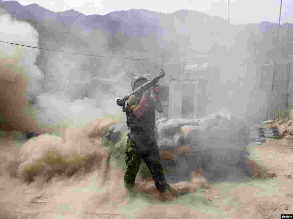 An Afghan national army soldier fires a rocket propelled grenade during a fire fight between Taliban militants and Afghan and U.S. soldiers in Kunar Province, Afghanistan on July 18.Photo by Baz Ratner for Reuters