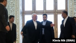 Foreign Minister Mohammad Javad Zarif (L) and Kazem Jalali (R). File photo