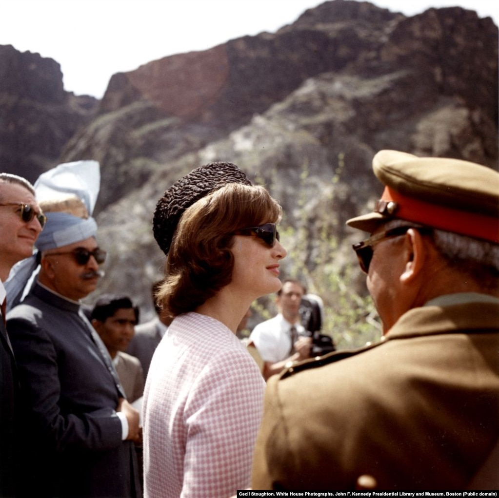 Jacqueline Kennedy in the Khyber Pass wearing a traditional karakul hat that President Khan had given to her. The trip was labeled a great success and was said to have marked some of the happiest days Kennedy spent as first lady. A year later her husband, President John F. Kennedy, was shot dead as she rode with him in a motorcade in Dallas.