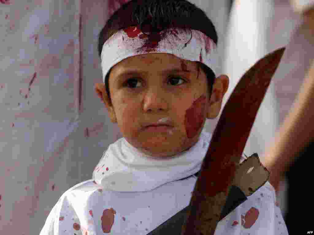 An Iraqi Shi'ite boy bleeds as he takes part in a ritual in the capital, Baghdad, on December 16 during the Ashura commemorations.Photo by Ahmad al-Rubaye for AFP