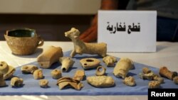 Looted artifacts recovered from Islamic State fighters are seen at the National Museum of Iraq in Baghdad in 2015.