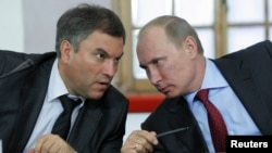Russian President Vladimir Putin (right) talks to government chief of staff Vyacheslav Volodin, one of those sanctioned in the latest round of sanctions against prominent Moscow insiders. (left)