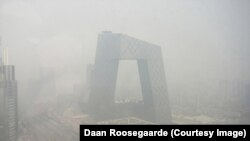 The CCTV tower in Beijing shrouded in smog.