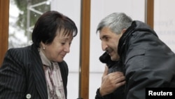 Presidential candidate Alla Dzhioyeva (left) meets with the head of the breakaway region of South Ossetia's Interior Ministry, Valery Valiev, on November 28.