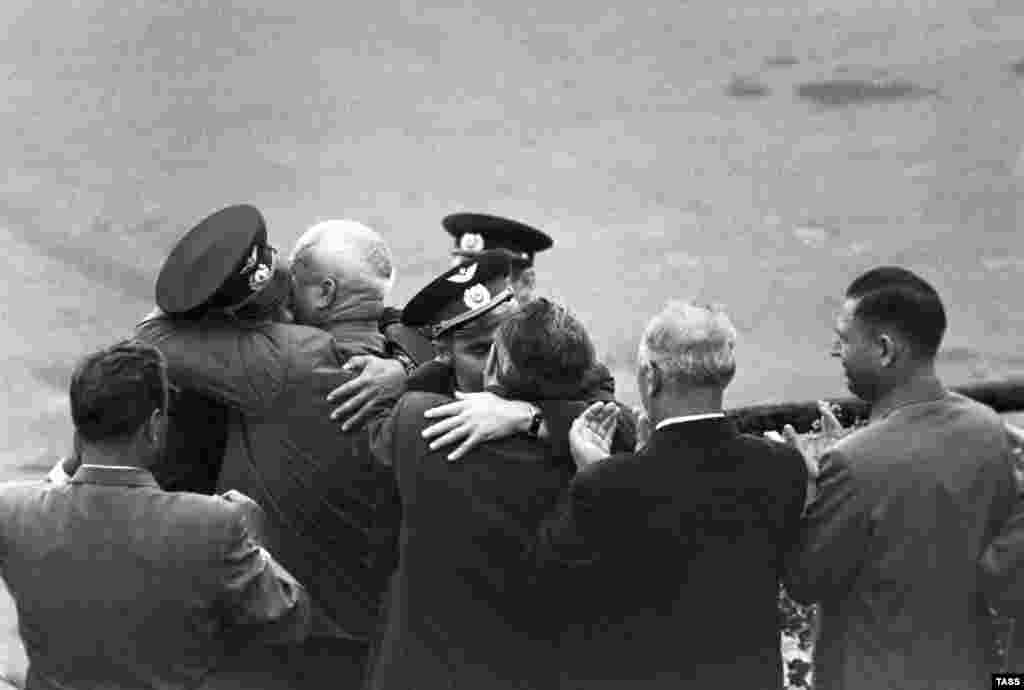 What looks like a last dance is actually a state event to welcome cosmonauts back to Earth led by Soviet leader Nikita Khrushchev (third from left).