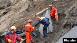 Armenia - A rescue team works at the site of a major landslide in northern Tavush region, 3Oct2011.