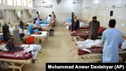 The injured receive treatment at a hospital following a suicide attack in Jalalabad on June 11.