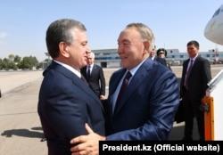Uzbek President Shavkat Mirziyoev (left) welcomes Kazakh President Nursultan Nazarbaev to Tashkent in September